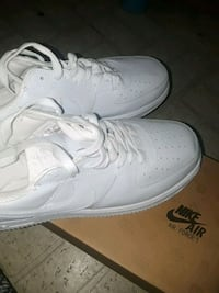 pair of white Nike Air Force 1 low shoes Austin, 78744