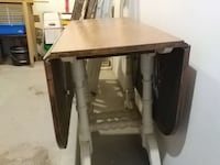 brown and white wooden droplift table 897 km