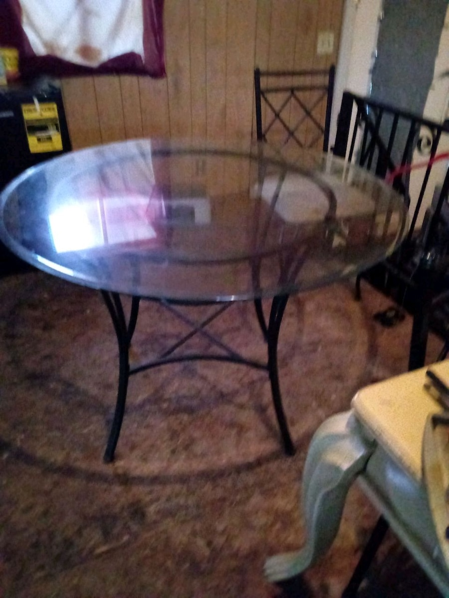 Photo Glass top Wrought Iron kitchen table. $60 table 4 chairs sold separat