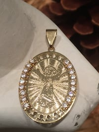 18k GPL Oval Divino Nino Pendant With Clear CZ