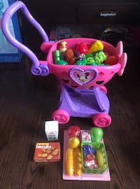 Gently used Minnie Mouse Shopping Cart Filled with Play Food/Some Dishware & Brand New Grocery Pack 564 km