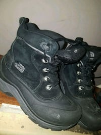 pair of black leather work boots 1962 km
