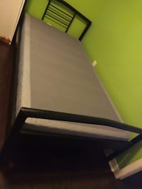 Black wooden bed frame and white mattress London, N6E 2B6