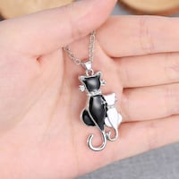 two black and white cat pendant