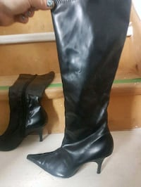 pair of women's black leather pointed-toe heeled thigh-high boots 635 km