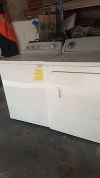 two white top load washer and front load dryer set Hyattsville, 20782