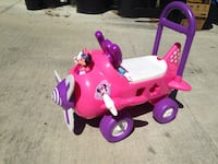 toddler's pink and purple Minnie Mouse plane ride-on toy Winter Haven, 33881