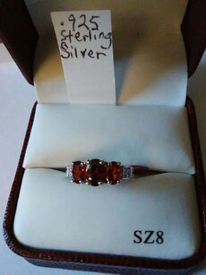silver and red gem embellish ring