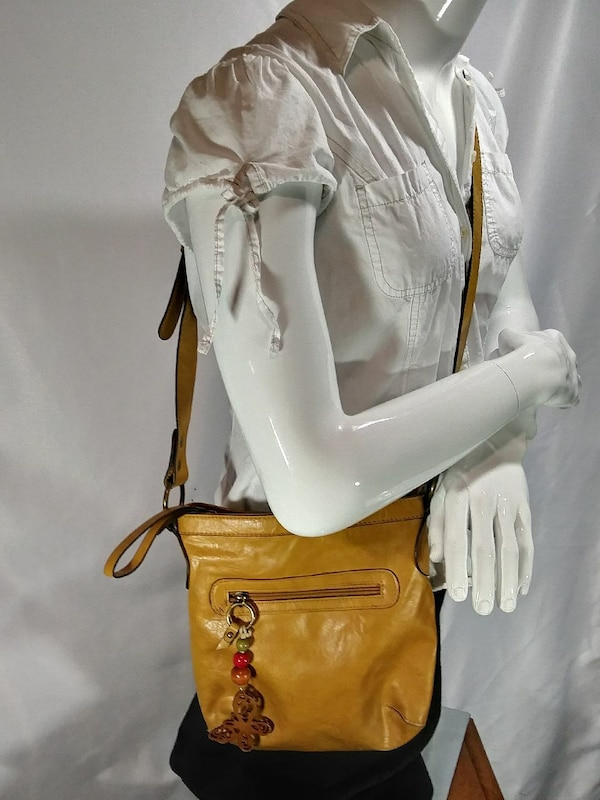 white button-up shirt and brown crossbody bag