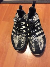Pair of black-and-white adidas sneakers sloop Richmond Hill, L4C 1J2