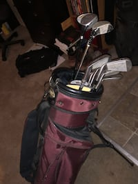 red and black golf bag with golf clubs 53 km
