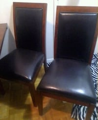 two black leather padded chairs Montreal