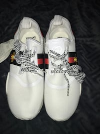 pair of white Adidas low-top sneakers St Catharines, L2P