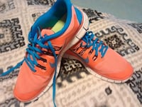 pair of orange-and-blue Nike running shoes