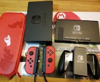 black Nintendo Switch console with controllers River Rouge, 48218