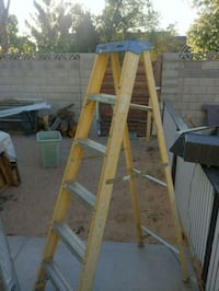 yellow and gray metal ladder