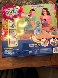 Dippin dots machine and packets.