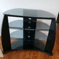 black and gray TV stand 724 km