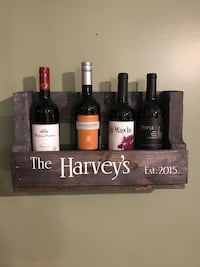 Brown wooden wall mounted wine rack