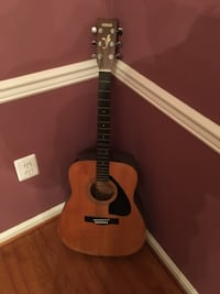 brown and black acoustic guitar CENTREVILLE