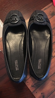 Pair of black Michael Kors leather flat shoes