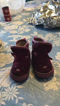 Girl's pair of maroon cat themed high top sneakers