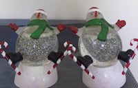 Two glass snowman figurines