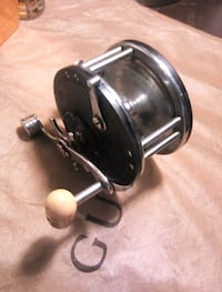 black and gray fishing reel Victoria, V8Z