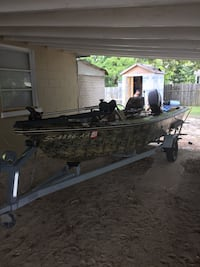 Green and black outboard boat