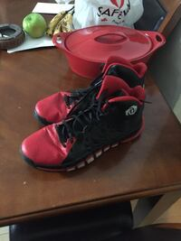 Pair of black-and-red adidas derrick rose basketball shoes