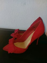 Pair of red high heel shoes Miami, 33137