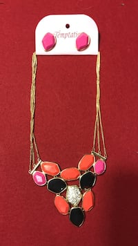 women's silver, brown, black, and pink necklace