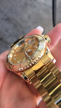 round gold-colored analog watch with link bracelet Clear Brook, 22624