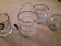 four clear glass hanging candle holders