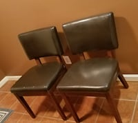 A PAIR OF LEATHER CUSHION CHAIRS Broadlands