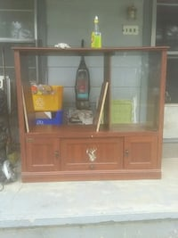 brown wooden TV hutch with flat screen television Jacksonville, 72076
