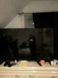 black flat screen TV with remote Clifton, 07011
