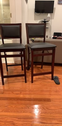 Two brown wooden bar stools