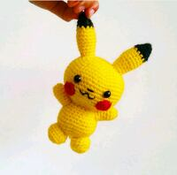yellow and red amigurumi doll