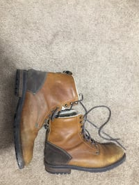 Pair of brown leather boots Calgary, T3J 2N2