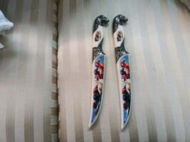 Ivory 6in painted knives 30.00 each.