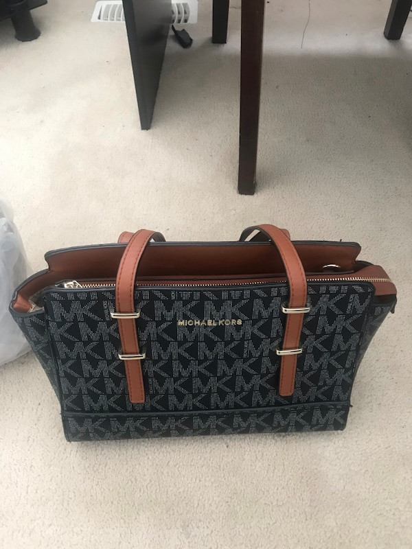 34f7cf5488c6c9 Used black and brown Michael Kors leather tote bag for sale in Brampton -  letgo