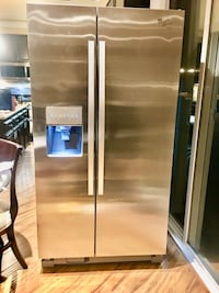 Whirlpool refrigerator side-by-side Stainless Steel.