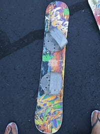 blue, red, green and yellow graffiti print snowboard