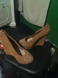 women's pair of brown suede studded wedge pumps