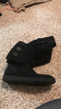 unpaired black UGG Cardy Tall boot