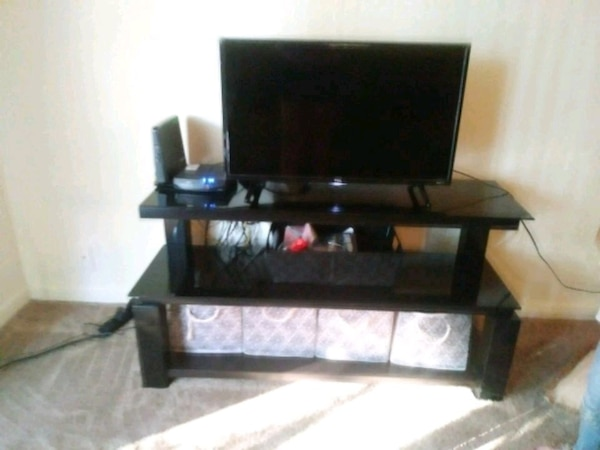 black wooden TV stand tv and accessories not incl