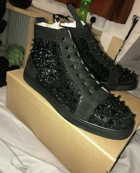 Pair of black leather high-top sneakers Orlando