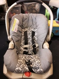 baby's grey, white, and black floral car seat carrier