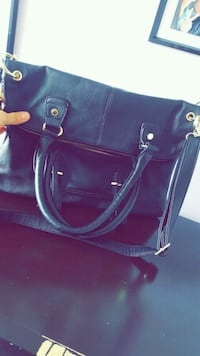 Steve Madden black purse.